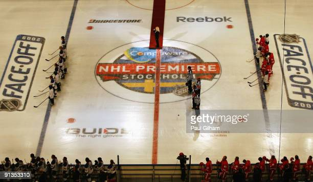 Players from Detroit Red Wings and St Louis Blues line up for the national anthems of United States and Sweden before the start of the 2009 Compuware...