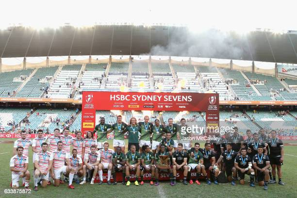 Players from England South Africa and New Zealand pose during the presentation at the conclusion of the 2017 HSBC Sydney Sevens at Allianz Stadium on...