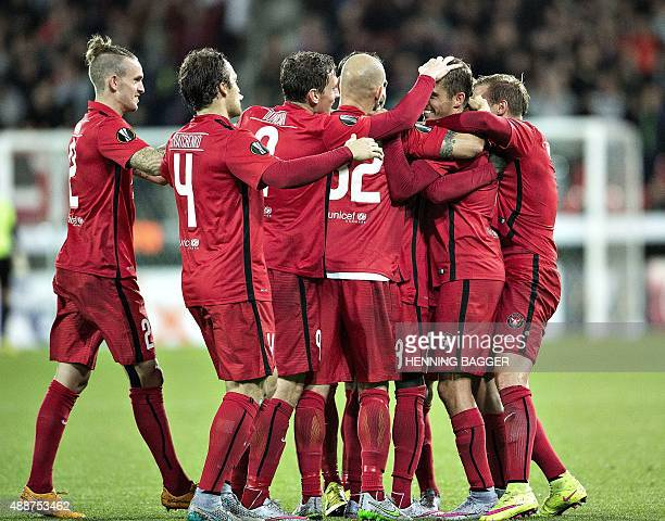 Players from FC Midtjylland celebrate after scoring against Legia Warszawa during the UEFA Europa League Group D football match between FC...
