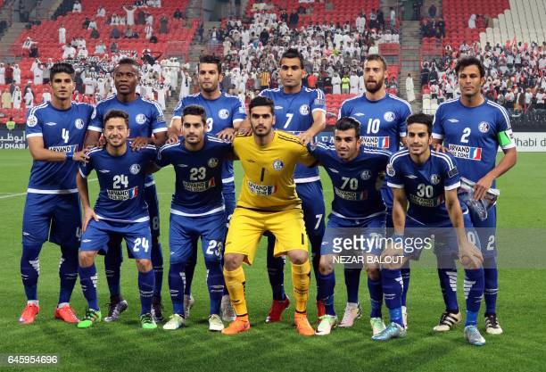 Players from Iran's Esteghlal Khuzestan club pose for a family picture before an Asian Champions League Group B football match between alJazira and...