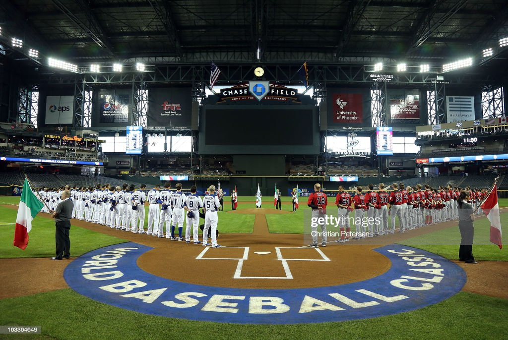 Players from Italy and Canada line up for the National Anthems before the World Baseball Classic First Round Group D game at Chase Field on March 8, 2013 in Phoenix, Arizona.
