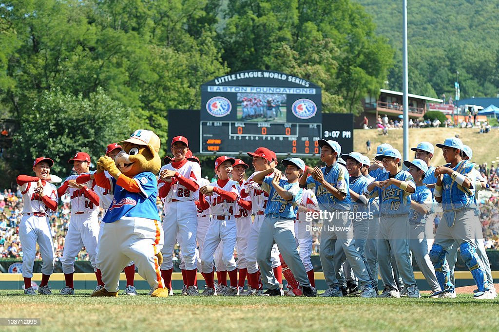 Players from Japan and the United States Little League teams, dance with mascot Dugout before the game on August 29, 2010 in South Willamsport, Pennsylvania. Japan won the Little League World Series Championship 4-1.