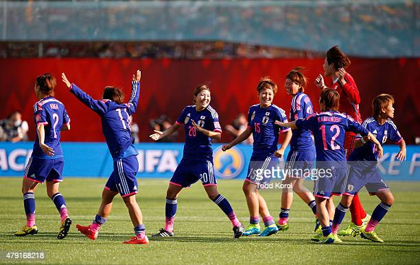 Players from Japan react after the defeated England during the FIFA Women's World Cup Canada Semi Final match between England and Japan at...