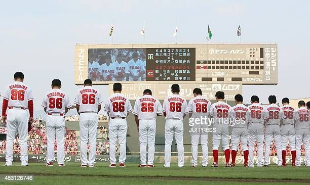 Players from Japanese professional baseball team Hiroshima Carp wear the number 86 on the back of their uniforms as they offer prayers for Abomb...