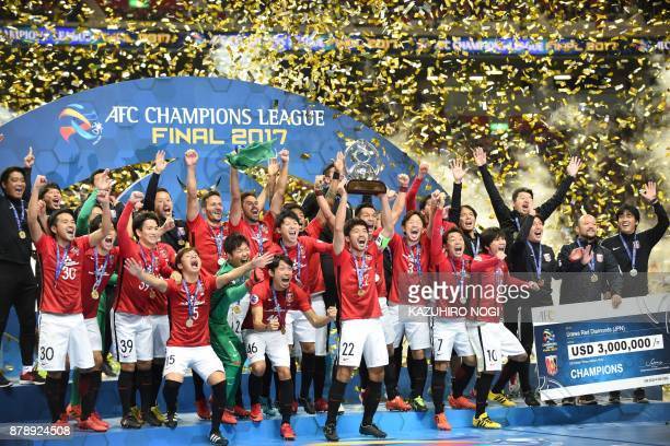 Players from Japan's Urawa Red Diamonds celebrate after beating Saudi Arabia's Al Hilal to win the AFC Champions League football final in Saitama on...