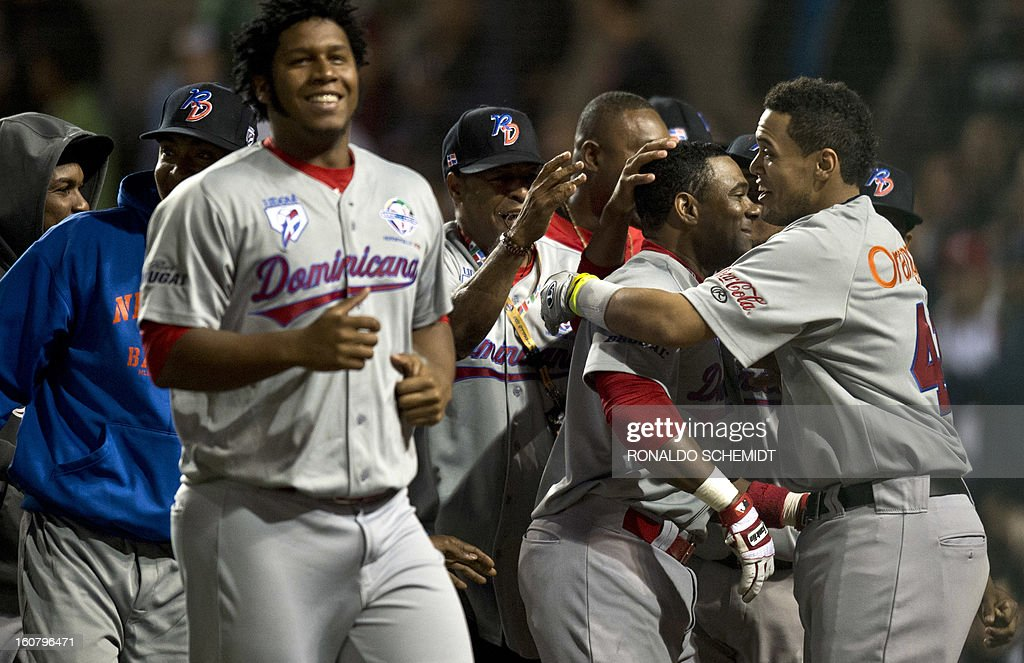 Players from Leones del Escogido of the Dominican Republic celebrates after a home run against Yaquis de Obregon of Mexico during the 2013 Caribbean baseball series on February 5, 2013, in Hermosillo, in the northern Mexican state of Sonora. AFP PHOTO / Ronaldo Schemidt