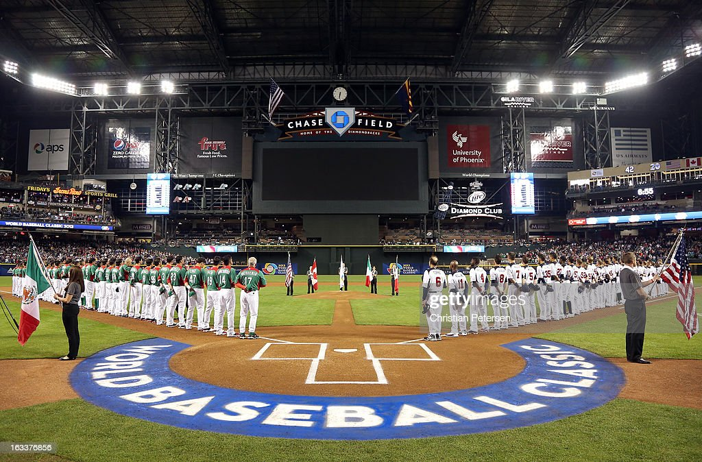 Players from Mexico and the United States line up on the foul lines prior to playing during the World Baseball Classic First Round Group D game at Chase Field on March 8, 2013 in Phoenix, Arizona.
