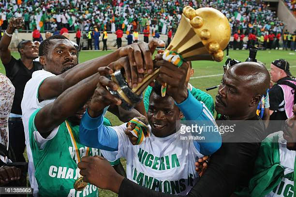 Players from Nigeria celebrate with the trophy after winning the 2013 Africa Cup of Nations Final match between Nigeria and Burkina at FNB Stadium on...
