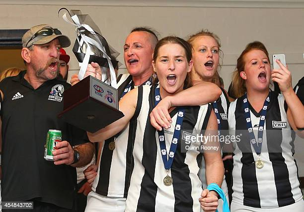 Players from North Geelong celebrate winning the Division 2 Grand Final of the Victorian Women's Football League match between Seaford and North...
