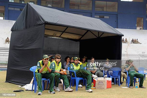 Players from Pakistan team relax during the second match of ICC Womens World Cup between Australia and Pakistan played at the Barabati stadium on...
