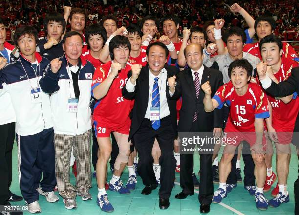 Players from South Korea celebrate after defeating Japan by 2825 during the replay of the Men's Olympic Asian Qualifier match between Japan v South...