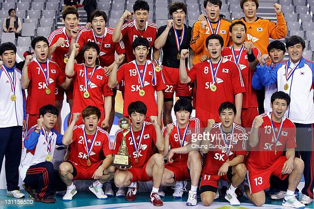 Players from South Korea celebrate after defeating Japan during the London Olympic Men's Handball Asian Qualifier Final match between Japan and South...