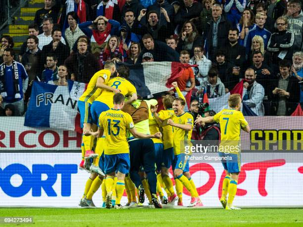 Players from Sweden celebrate Ola Toivonen's match winning in injury time during the FIFA 2018 World Cup Qualifier between Sweden and France at...