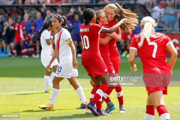 Players from Team Canada celebrate yet another goal against Team Costa Rica during the second half in a exhibition match on June 11 2017 at BMO Field...