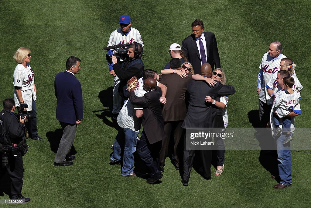 Players from the 1986 World Champion New York Mets including Tim Teufel, Bob Ojeda, Darryl Strawberry, Keith Hernandez, Mookie Wilson and Ron Darling greet the family of former Mets' catcher and Hall of Famer Gary Carter including his wife Sandy, son D.J. and daughters Kimmy and Christy as they honor Carter during their Opening Day Game against the Atlanta Braves at Citi Field on April 5, 2012 in New York City.