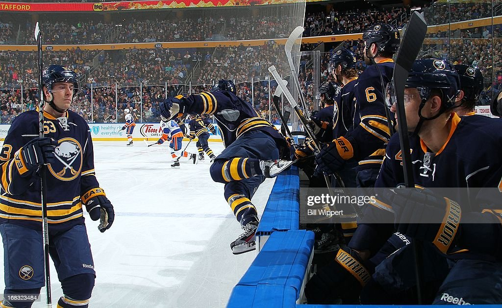 Players from the Buffalo Sabres change on the fly in a game against the New York Islanders on April 26, 2013 at the First Niagara Center in Buffalo, New York.