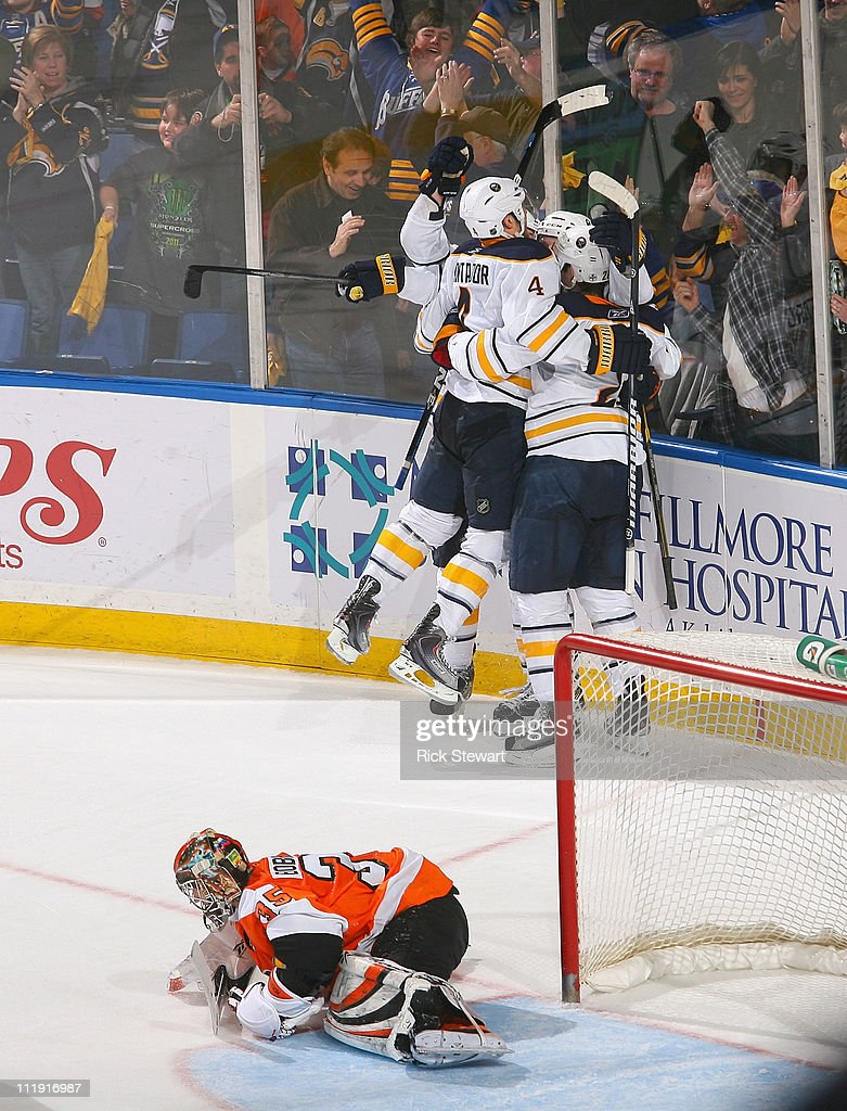 Players from the Buffalo Sabres skate to <a gi-track='captionPersonalityLinkClicked' href=/galleries/search?phrase=Thomas+Vanek&family=editorial&specificpeople=570606 ng-click='$event.stopPropagation()'>Thomas Vanek</a> #26 after Vanek scored the game winning goal in overtime against <a gi-track='captionPersonalityLinkClicked' href=/galleries/search?phrase=Sergei+Bobrovsky&family=editorial&specificpeople=4488556 ng-click='$event.stopPropagation()'>Sergei Bobrovsky</a> #35 of the Philadelphia Flyers at HSBC Arena on April 8, 2011 in Buffalo, New York. Buffalo won 4-3 in overtime and clinched a spot in the NHL Playoffs.
