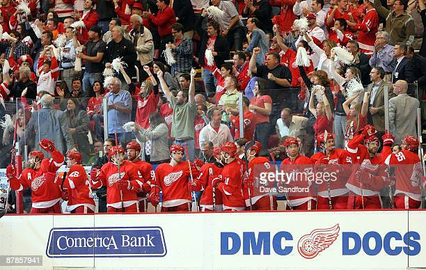 Players from the Detroit Red Wings celebrate on the bench along with their fans after Brian Rafalski scored a power play goal in the first period...
