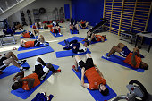 Players from the French national Rugby team perform stretching exercises during an indoor training session on February 10 2015 in Marcoussis south of...