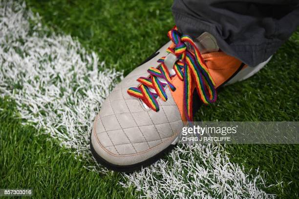 Players from the gay supporters' teams of Arsenal and Brighton wear rainbow laces as they take part in a penalty shootout competition at the Arsenal...
