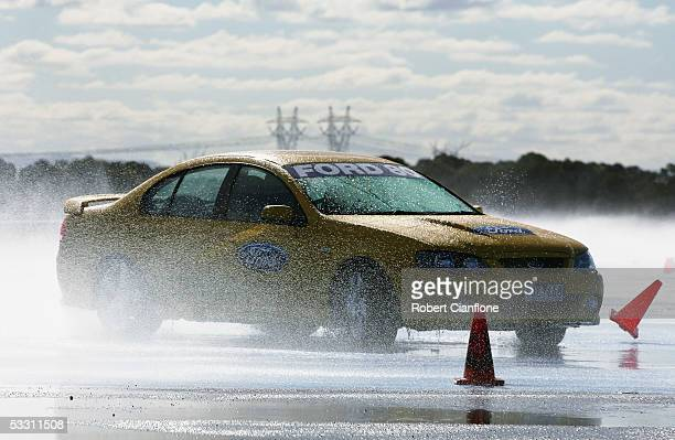 Players from the Geelong Cats test their driving skills on a skid pan during the Geelong FC Ford Drive Day at the Ford Australia Proving Ground...