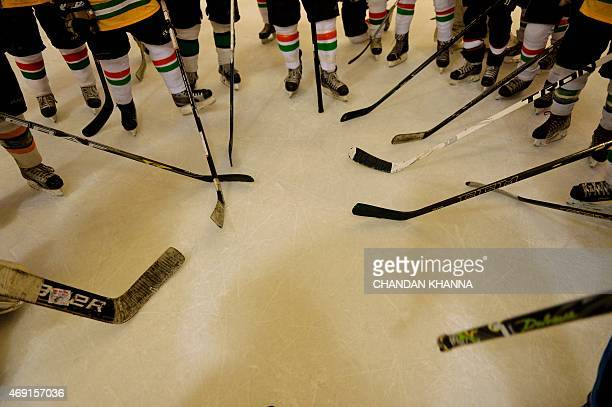 Players from the Indian ice hockey team take part in a practice session inside an ice skating bar and café in a mall in Gurgaon on the outskirts of...