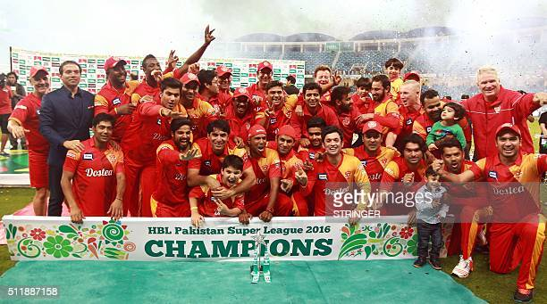 Players from the Islamabad United team celebrate winning the final of the Pakistan Super League against Quetta Gladiators at the Dubai cricket...