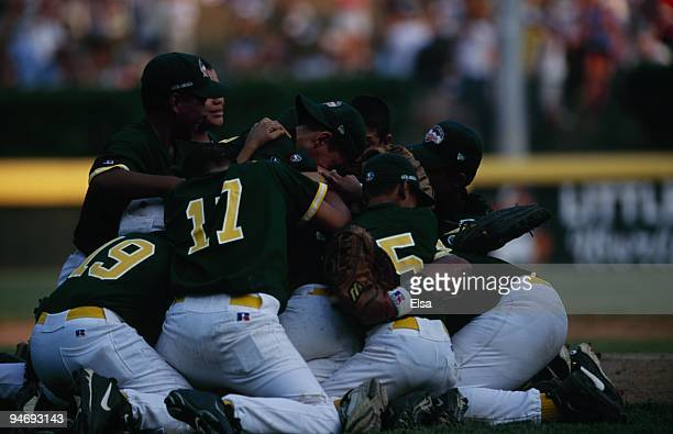Players from the Latin American team celebrate on the field during their Little League World Series game against the United States at Howard J World...