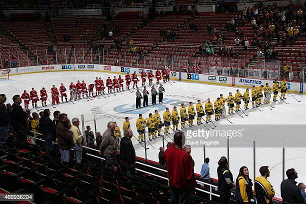 Players from the Michigan Wolverines and the Wisconsin Badgers line up at center ice for the national anthem before game two of the Big Ten Men's Ice...