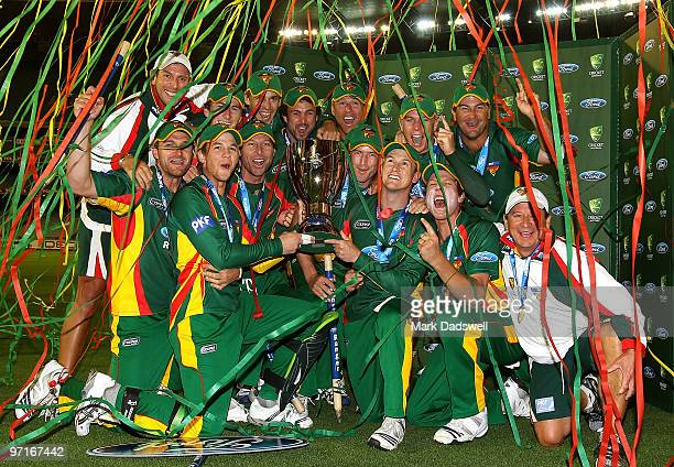 Players from the Tasmanian Tigers celebrate with the Cup after winning the Ford Ranger Cup Final match between the Victorian Bushrangers and the...