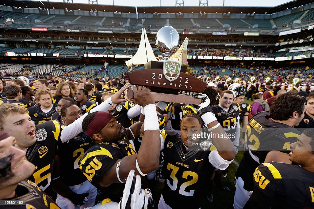 Players from the the Arizona State Sun Devils lift the trophy after they beat the Navy Midshipmen in the Kraft Fight Hunger Bowl at AT&T Park on December 29, 2012 in San Francisco, California.