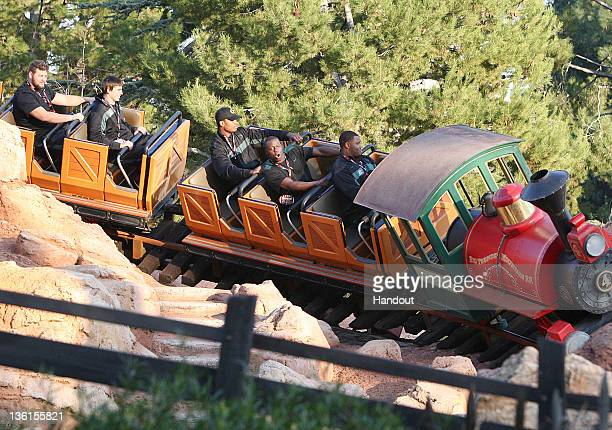Players from the University of Oregon Ducks celebrating the 98th Rose Bowl Game ride Big thunder Mountain Railroad at Disneyland park on December 27...