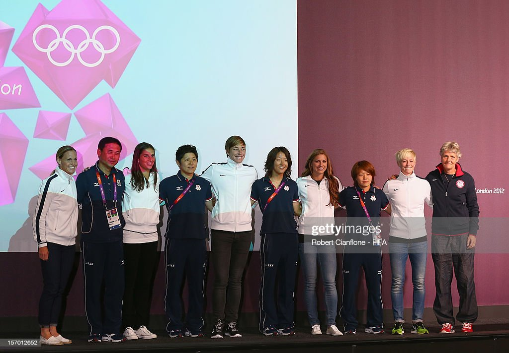 Players from the USA and Japan pose for the media during the Women's Football Final press conference at the Main Press Centre as part of the London 2012 Olympic Games on August 8, 2012 in Newcastle upon Tyne, England.