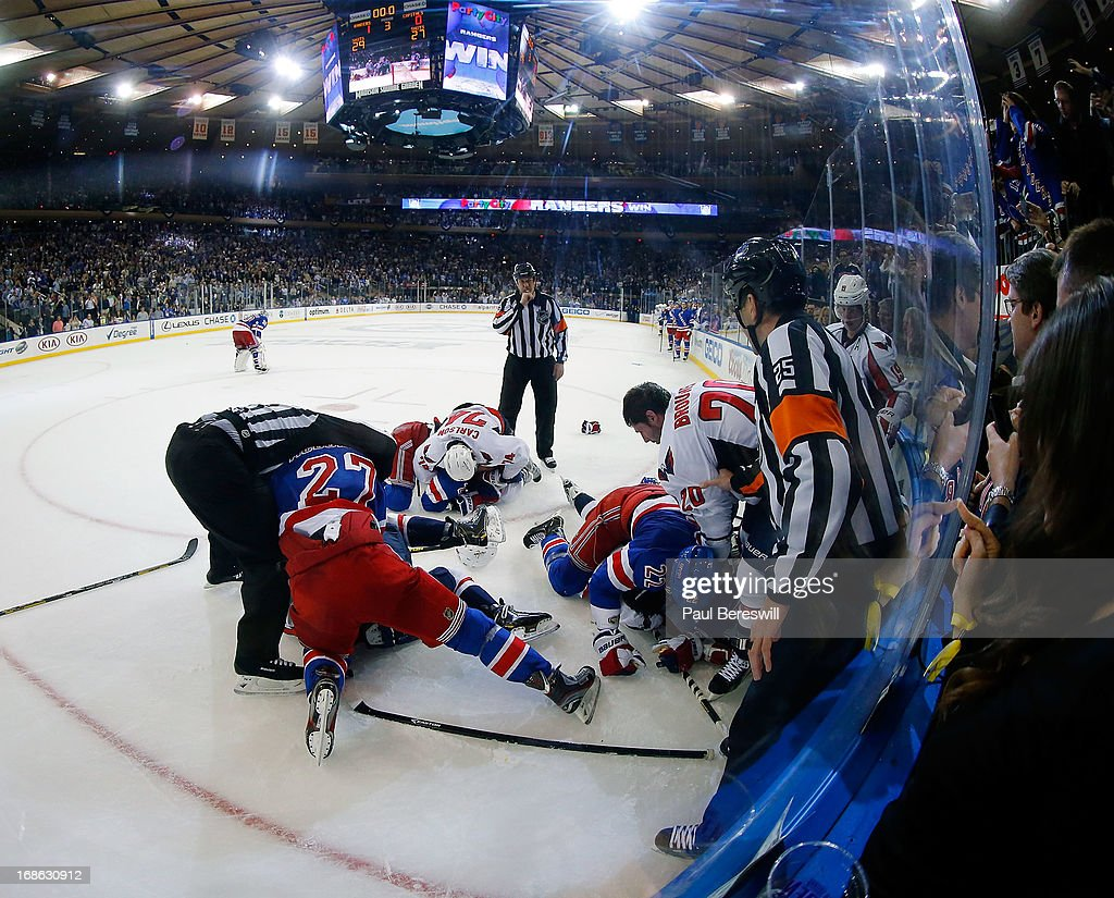 Players from the Washington Capitals and the New York Rangers fight after the buzzer ending the game as Game Six of the Eastern Conference Quarterfinals during the 2013 NHL Stanley Cup Playoffs at Madison Square Garden on May 12, 2013 in New York City. Rangers won 1-0.