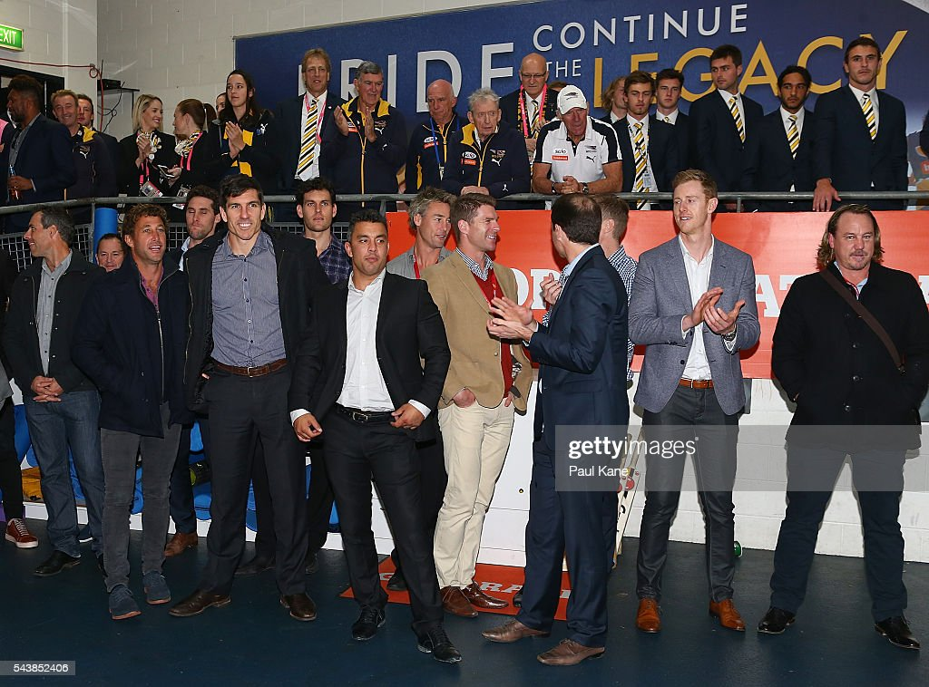Players from the West Coast Eagles 2006 Premiership Team look on as the 2016 team sing the club song after winning the round 15 AFL match between the West Coast Eagles and the Essendon Bombers at Domain Stadium on June 30, 2016 in Perth, Australia.