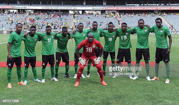 Players from the Zambia national team pose for a photograph ahead of the friendly football match between Zambia and South Africa at the Orlando...