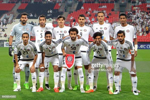 Players from UAE's alJazira club pose for a family picture before an Asian Champions League Group B football match between alJazira and Esteghlal...