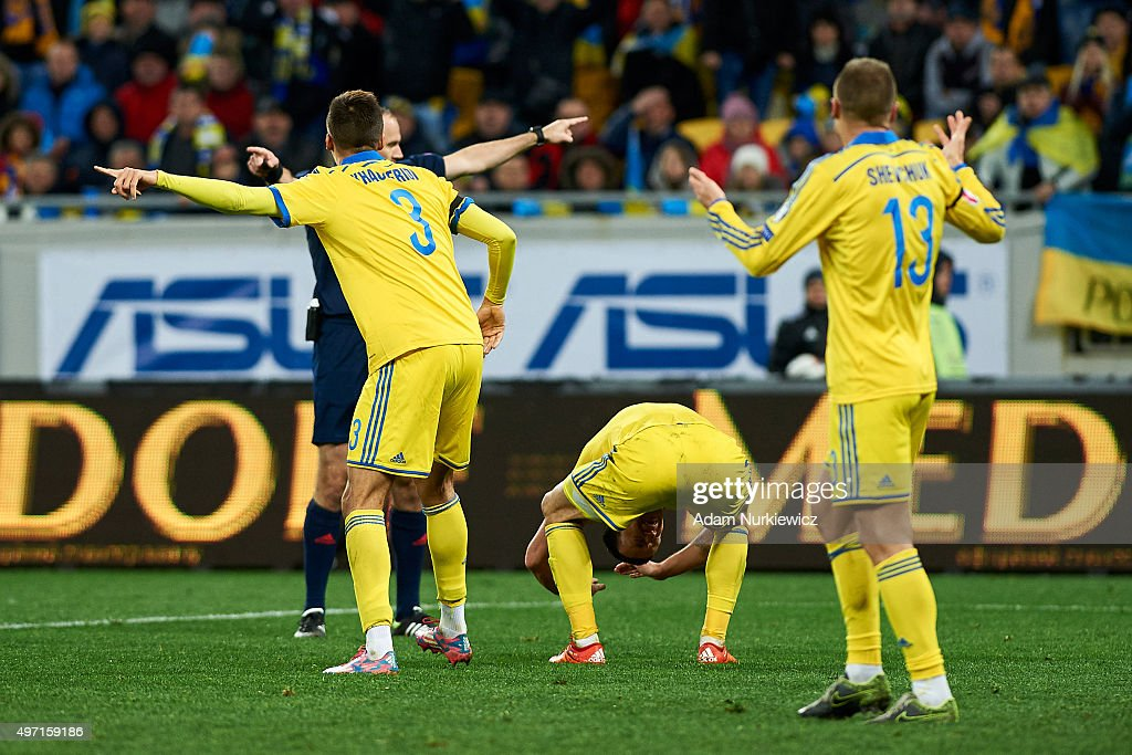 Players from Ukraine protest to referee <a gi-track='captionPersonalityLinkClicked' href=/galleries/search?phrase=Jonas+Eriksson+-+Referee&family=editorial&specificpeople=12731953 ng-click='$event.stopPropagation()'>Jonas Eriksson</a> from Sweden during the UEFA EURO 2016 Play-off for Final Tournament, First leg between Ukraine and Slovenia at Lviv Arena on November 14, 2015 in Lviv, Ukraine.