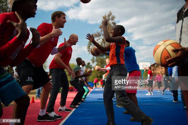 NBA players from various countries interact with children during a basketball clinic practice on the eve of the NBA Africa Game 2017 basketball match...