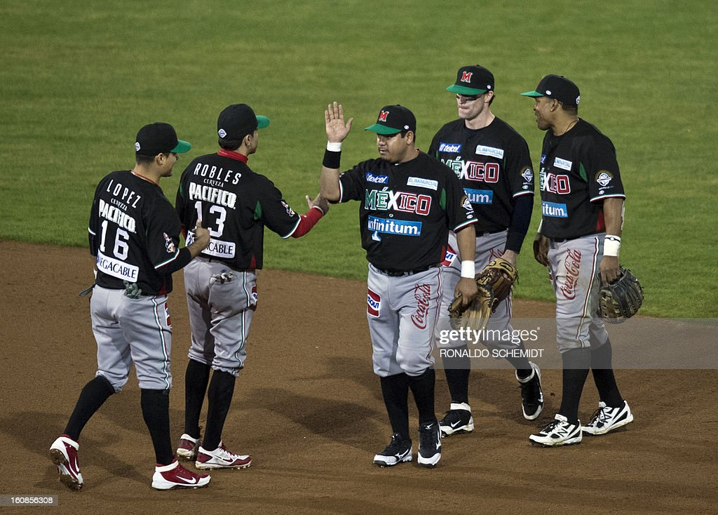 Players from Yaquis de Obregon of Mexico celebrate their victory over Criollos de Caguas of Puerto Rico during the 2013 Caribbean baseball series on February 6, 2013, in Hermosillo in the northern Mexican state of Sonora. The Mexican team won 10-0. AFP PHOTO/Ronaldo Schemidt
