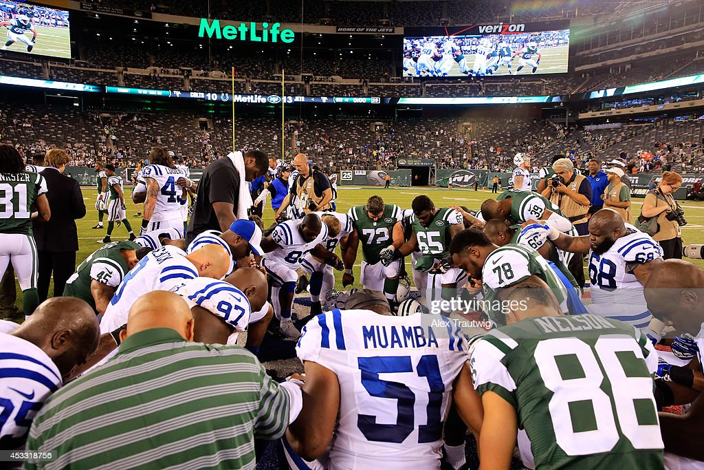 Players gather on the field following a preseason game between the New York Jets and the Indianapolis Colts at MetLife Stadium on August 7, 2014 in East Rutherford, New Jersey.