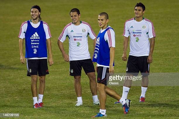 Players Gerardo Lugo Javier Hernandez and Edgar Andradein action during a training session of the Mexican National Soccer Team at Cuscatlan Staduim...