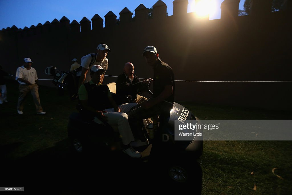 Players get a lift into the clubhouse by European Tour referee Gary Butler during the first round of the Trophee du Hassan II Golf at Golf du Palais Royal on March 28, 2013 in Agadir, Morocco.