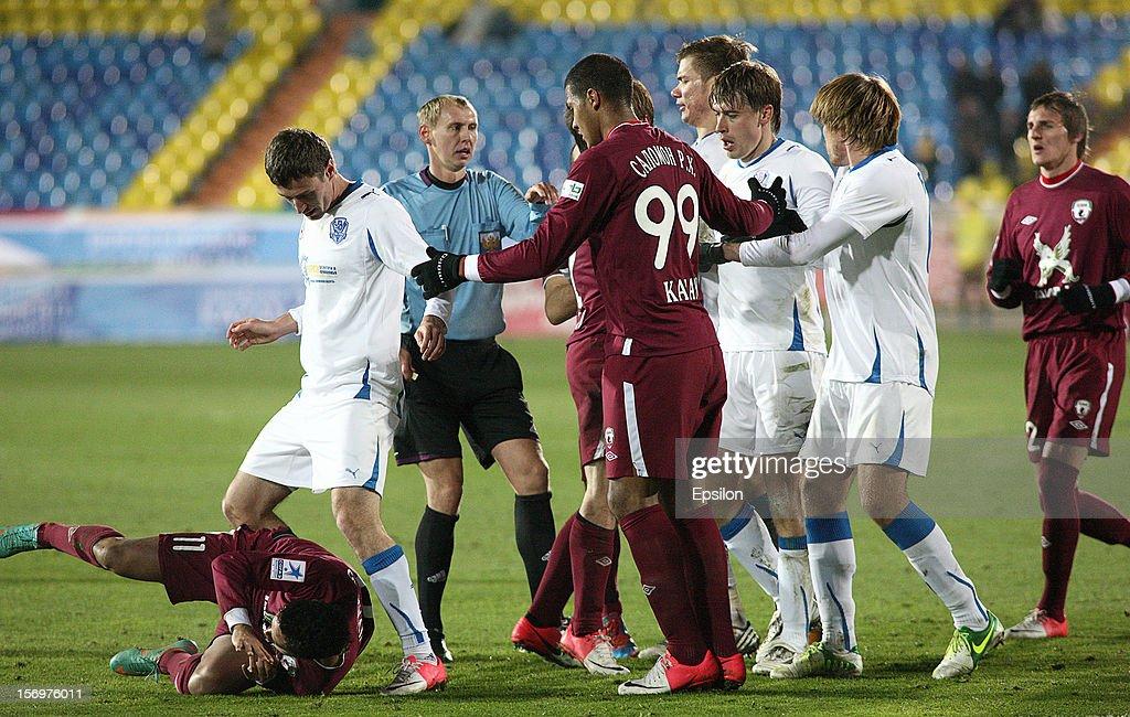 Players get into a dispute during the Russian Premier League match between FC Rubin Kazan and FC Volga Nizhny Novgorod at the Tsentraliniy Stadium on November 26, 2012 in Kazan, Russia.