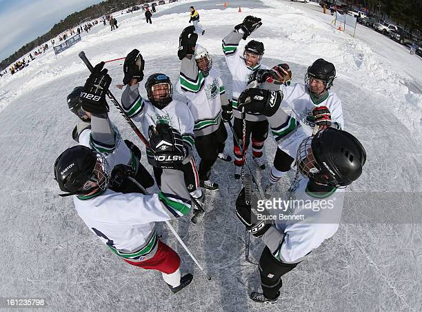 Players get prepared for their game at the 2013 USA Hockey Pond Hockey National Championships on February 9 2013 in Eagle River Wisconsin The...