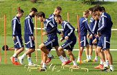 Players go through warm up exercise during a Sunderland AFC Training Session at The Academy of Light on September 11 2014 in Sunderland England