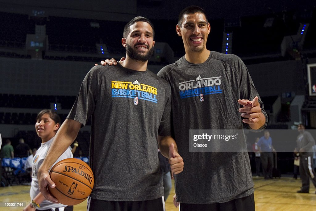 Players <a gi-track='captionPersonalityLinkClicked' href=/galleries/search?phrase=Greivis+Vasquez&family=editorial&specificpeople=4066977 ng-click='$event.stopPropagation()'>Greivis Vasquez</a> and <a gi-track='captionPersonalityLinkClicked' href=/galleries/search?phrase=Gustavo+Ayon&family=editorial&specificpeople=4474343 ng-click='$event.stopPropagation()'>Gustavo Ayon</a> pose for a picture during a training session of New Orleans Hornets and Orlando Magic with disabled people at Arena on October 06, 2012 in Mexico City, Mexico.