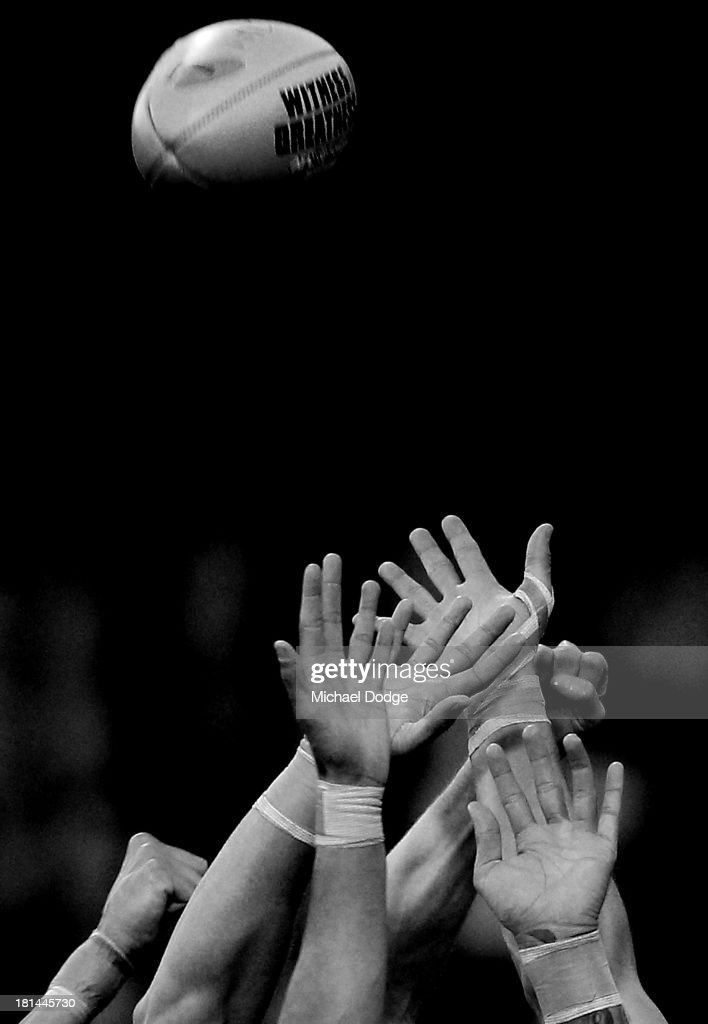 Players hands contest for the ball during the AFL Second Preliminary Final match between the Fremantle Dockers and the Sydney Swans at Patersons Stadium on September 21, 2013 in Perth, Australia.