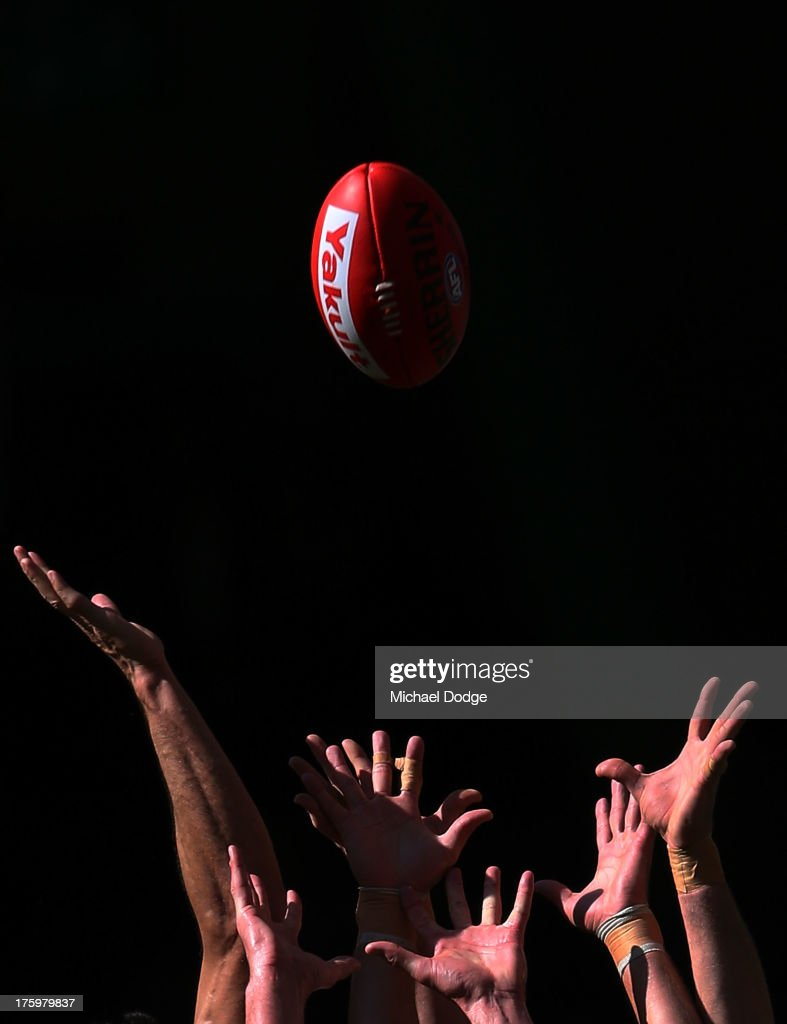 Players hands reach for the ball during the round 20 AFL match between the Essendon Bombers and the West Coast Eagles at Etihad Stadium on August 11, 2013 in Melbourne, Australia.