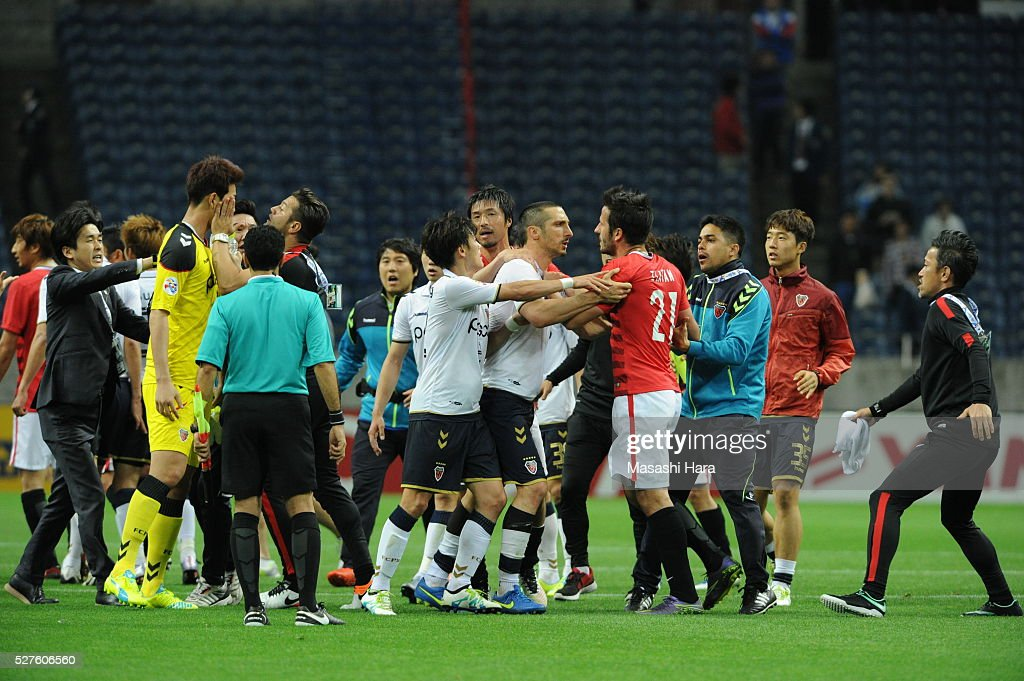 Players have trouble after the AFC Champions League Group H match between Urawa Red Diamonds and Pohang Steelers at the Saitama Stadium on May 3, 2016 in Saitama, Japan.